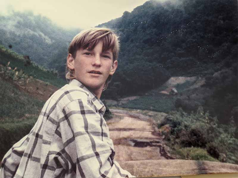boy in a mountain hike