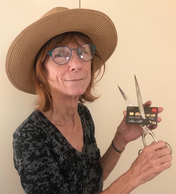 woman with giant scissors cutting up her Wells Fargo Visa