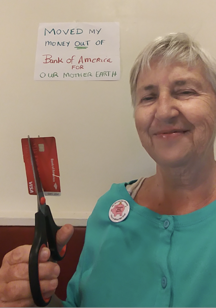 photo of woman with scissors who cut up her credit card