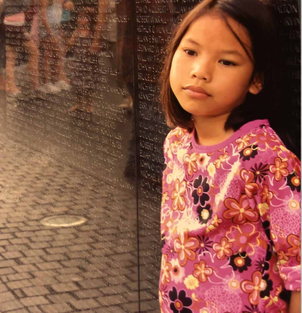 Girls leaning on Vietnam Veterans Memorial wall