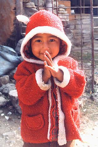 child in red hooded jacket smiling
