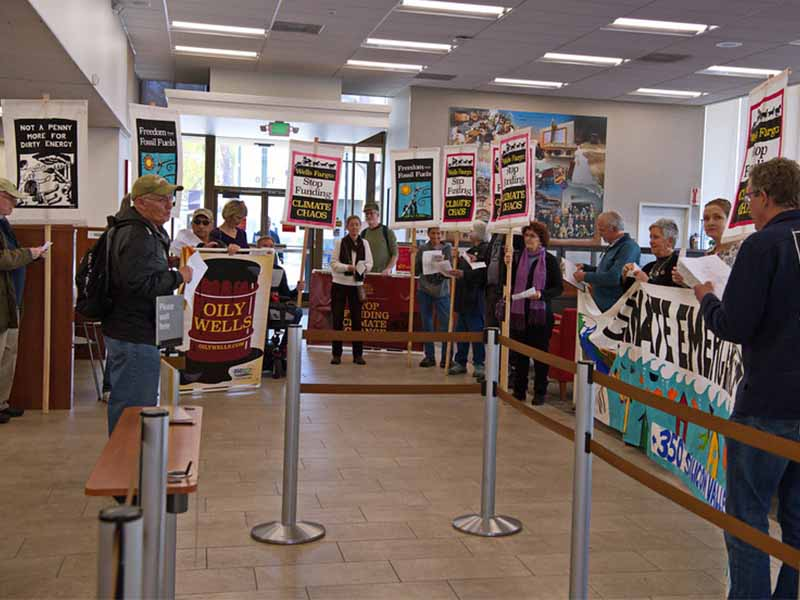 protesters demonstrating inside a bank